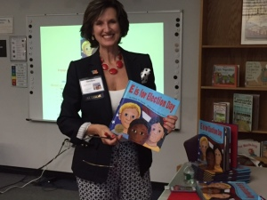 "Gloria Gavris, above, displayed her book during her engaging presentation, ""E is for Election."""