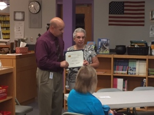 John Mendes is shown receiving the Celebrate Literacy Award from Terrie Marr, a member of the NRC Board of Directors.